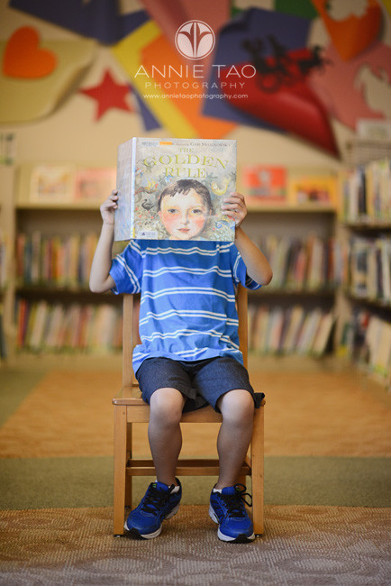 East-Bay-lifestyle-children-photography-library-young-boy-holding-a-book-with-a-head