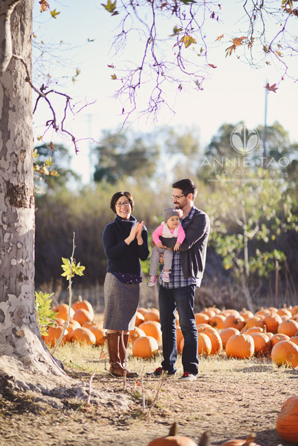 East-Bay-lifestyle-family-photography-parents-playing-with-baby-at-pumpkin-patch