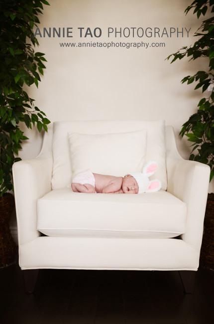 San-Francisco-Bay-Area-Newborn-Photography-baby-in-bunny-hat-sleeping-on-chair