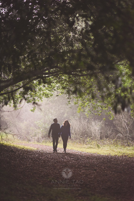 East-Bay-lifestyle-couple-photography-holding-hands-walking-in-forest-silhouette
