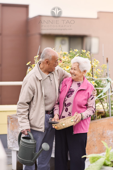 San-Francisco-commercial-photography-senior-man-happily-holding-wife-on-rooftop-garden