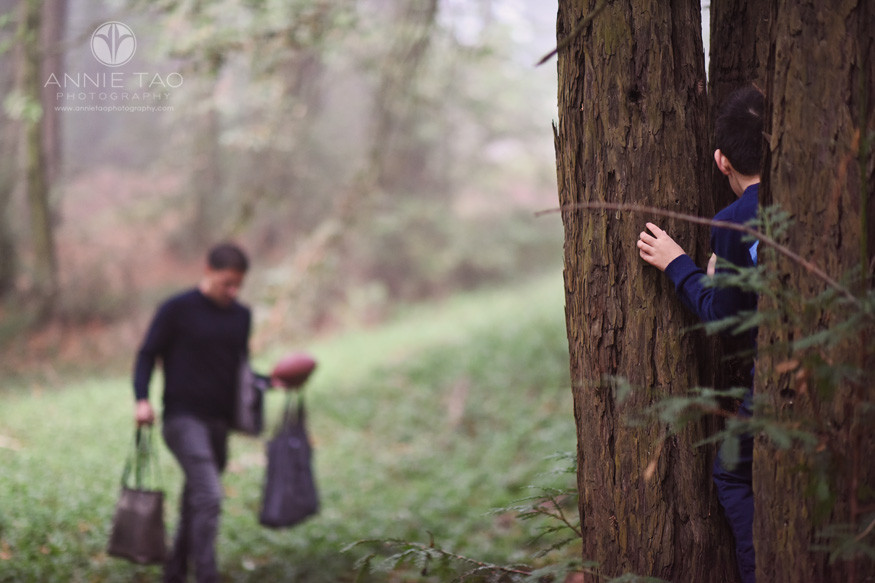 East-Bay-lifestyle-children-photography-boy-hiding-from-dad-in-forest