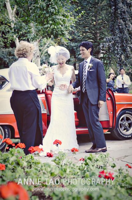 Los-Altos-Wedding-Photography-cocktail-hour-bride-and-groom-arrive-by-antique-car