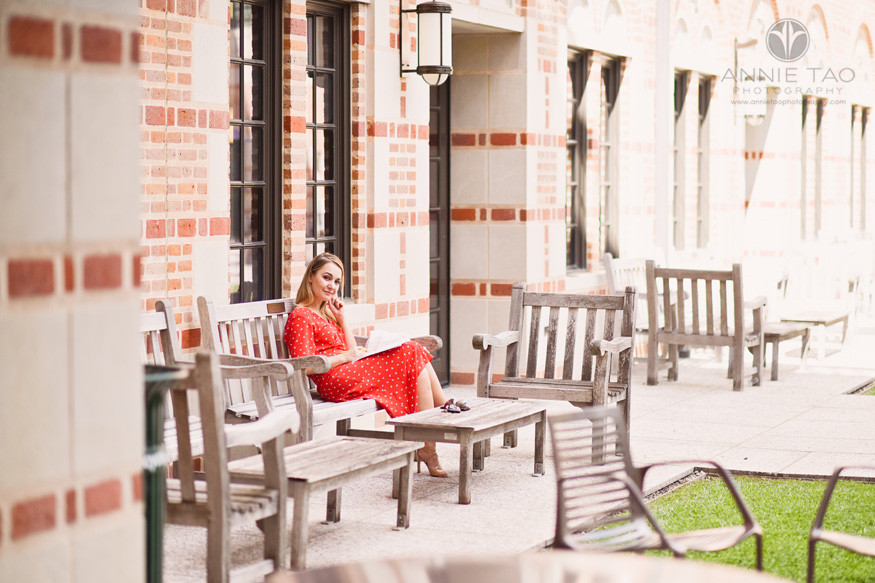 Commercial-Photography-Rice-Business-School-professor-in-red-dress-grading-papers-outdoors