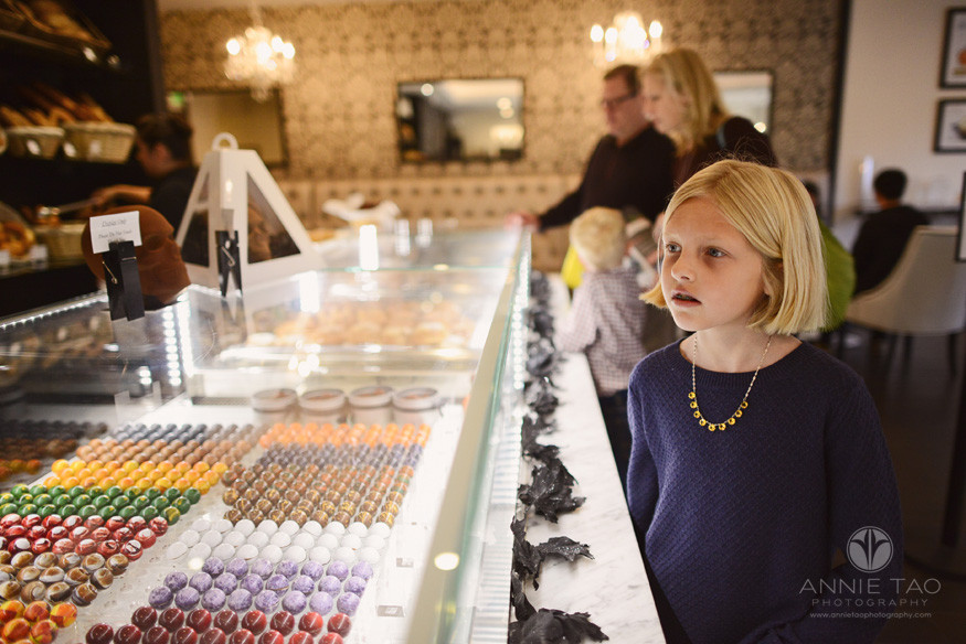 Bay-Area-lifestyle-children-photography-girl-at-patisserie-counter