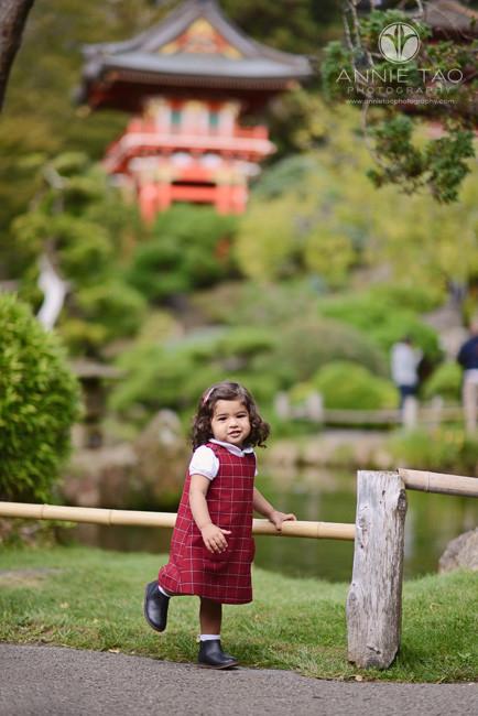 San-Francisco-lifestyle-children-photography-toddler-girl-lifting-leg-in-Japanese-garden