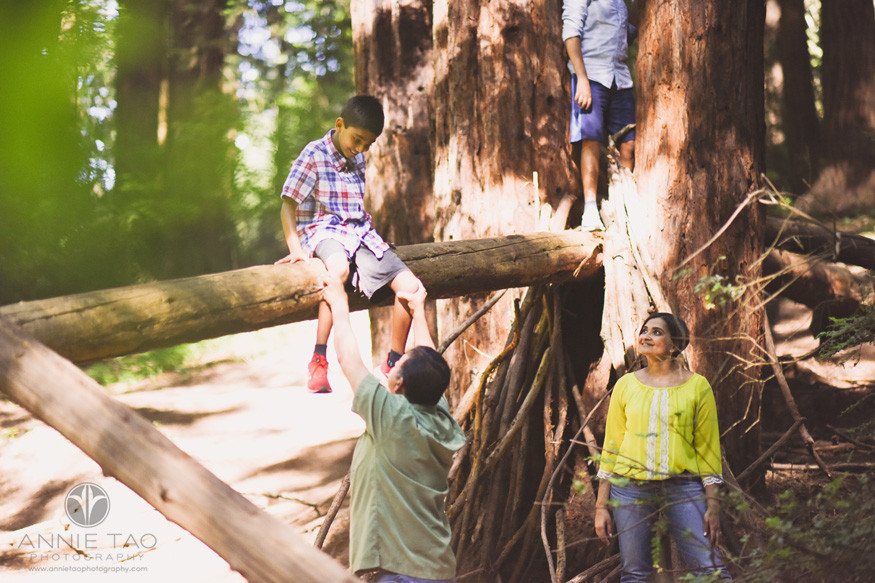 East-Bay-lifestyle-family-photography-parents-watching-and-helping-sons-in-Forest