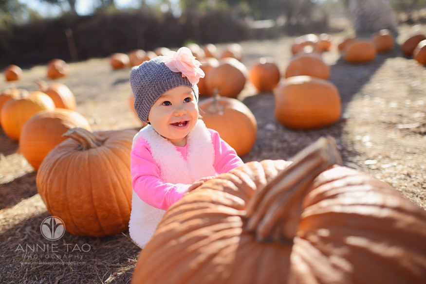 East-Bay-lifestyle-baby-photography-baby-girl-happy-with-pumpkins