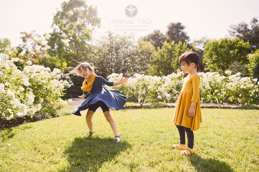 Bay-Area-lifestyle-children-photography-sisters-dancing-in-garden-3