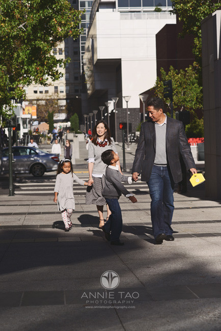 San-Francisco-lifestyle-family-photography-family-crossing-downtown-city-street-and-boy-looks-up-at-dad