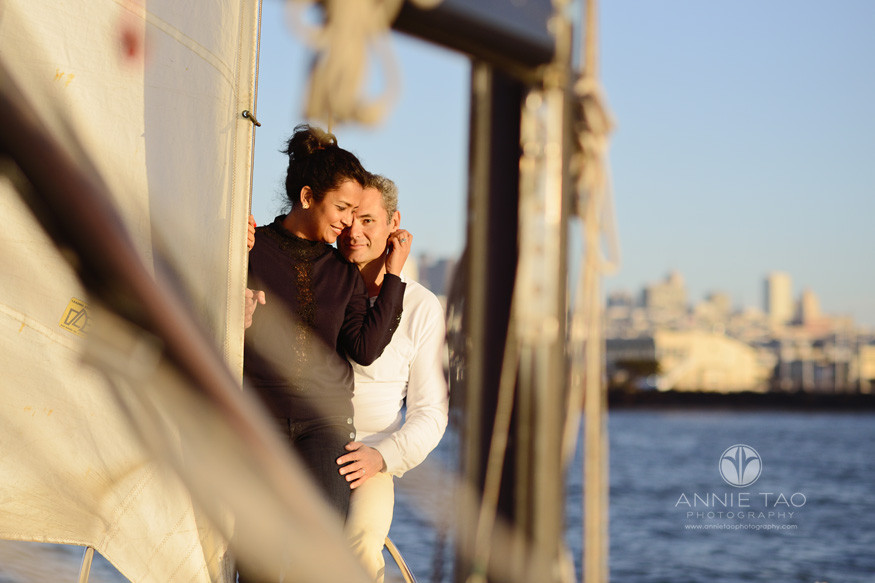 san-francisco-lifestyle-photography-couple-embracing-on-top-of-sailboat-in-bay