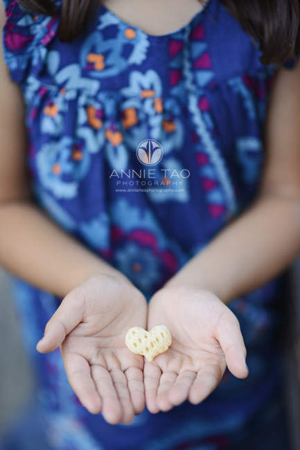 Bay-Area-San-Francisco-lifestyle-children-photography-little-hands-holding-heart-shaped-snack