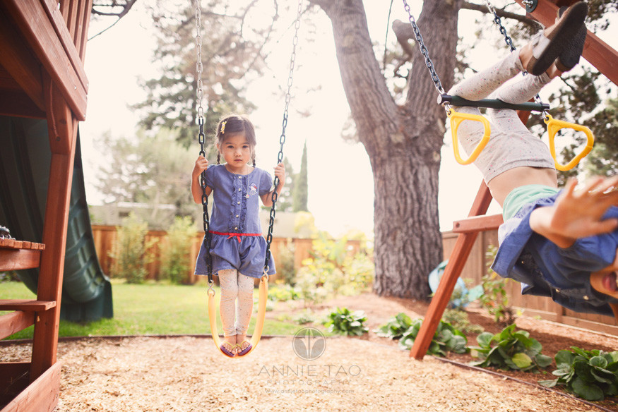 East-Bay-lifestyle-children-photography-sisters-playing-differently-on-swing-set