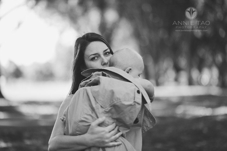 East-Bay-lifestyle-baby-photography-mother-keeping-baby-warm-with-coat-BxW
