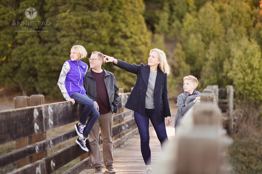South-Bay-lifestyle-family-photography-woman-pointing-and-family-looking-while-on-wooden-bridge
