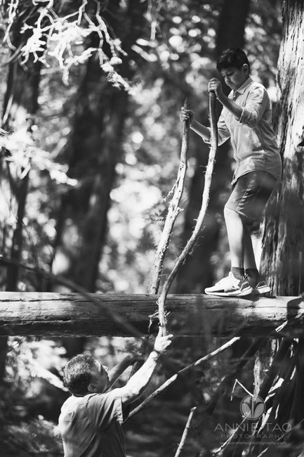 East-Bay-lifestyle-family-photography-father-giving-branches-to-son-for-balance-in-forest