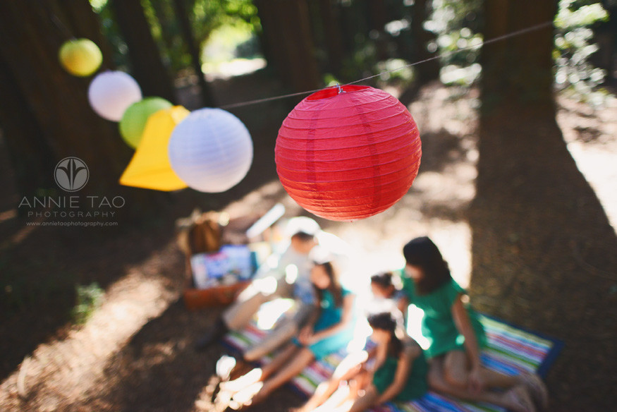 East-Bay-styled-family-photography-paper-lanterns-above-family