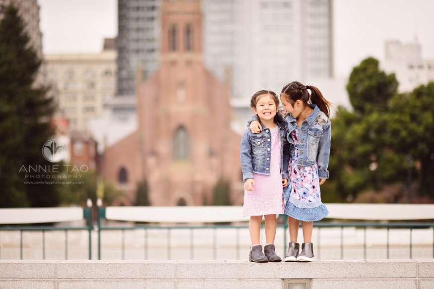 San-Francisco-lifestyle-children-photography-girls-laughing-together-on-wall