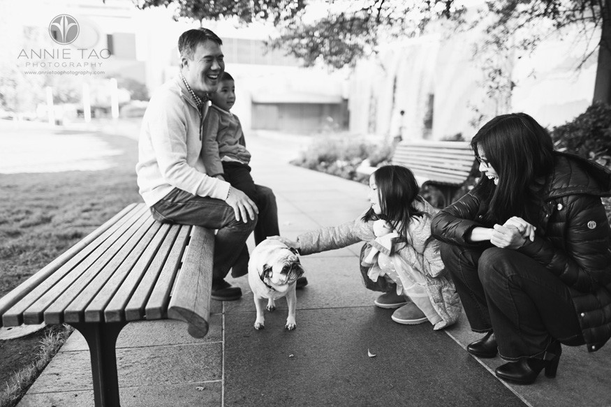 San-Francisco-lifestyle-family-photography-parents-laughing-while-petting-pug-BxW