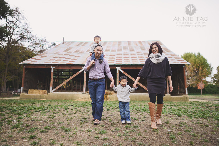 East-Bay-lifestyle-family-photography-walking-while-holding-hands-by-farmhouse