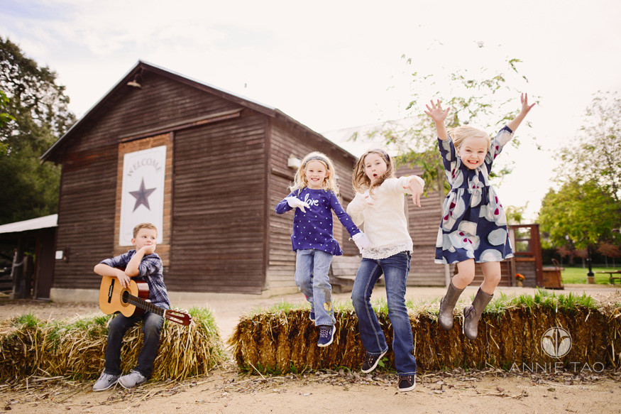 east-bay-lifestyle-children-photography-kids-jumping-off-haybales-at-farm