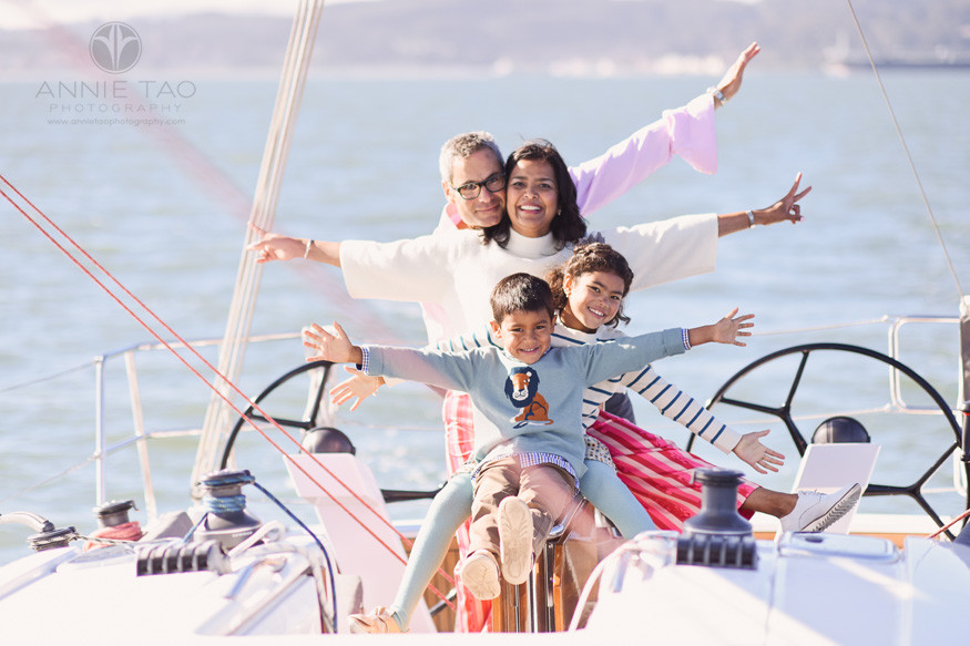 San-Francisco-lifestyle-family-photography-with-arms-out-while-sailing-in-bay