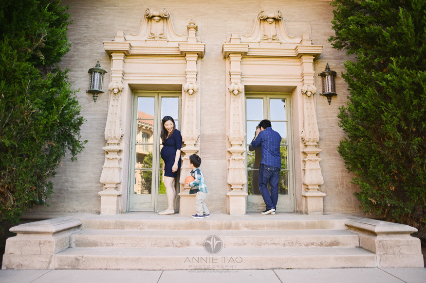 Bay-Area-lifestyle-family-photography-pregnant-woman-playing-with-toddler-son-while-father-peeks-in-window