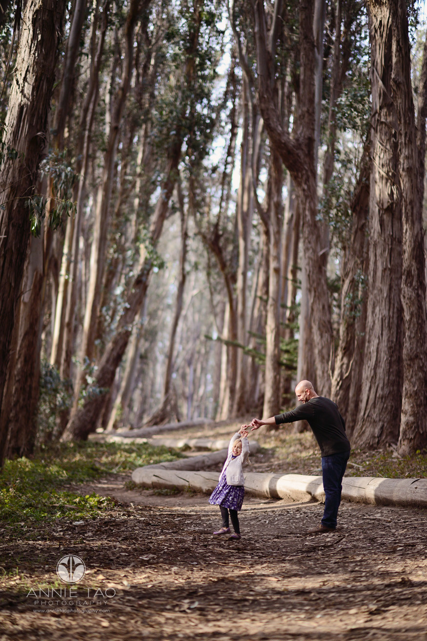 San-Francisco-lifestyle-family-photography-father-twirling-daughter-in-woods-lg