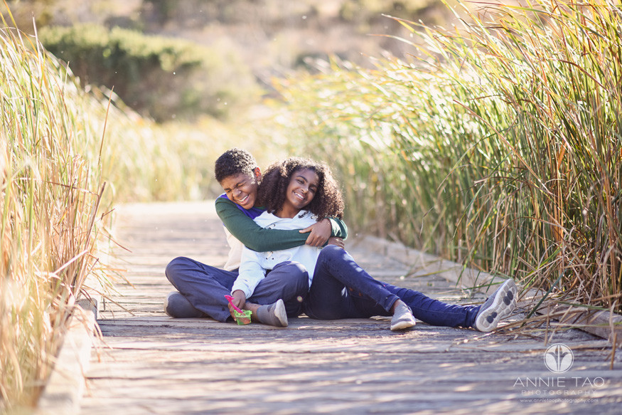 South-Bay-lifestyle-children-photography-siblings-hugging-and-laughing-on-marsh-walkway