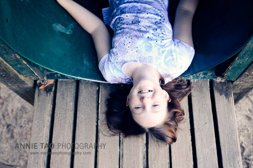 East-Bay-lifestyle-children-photography-preteen-girl-laying-down-on-play-structure