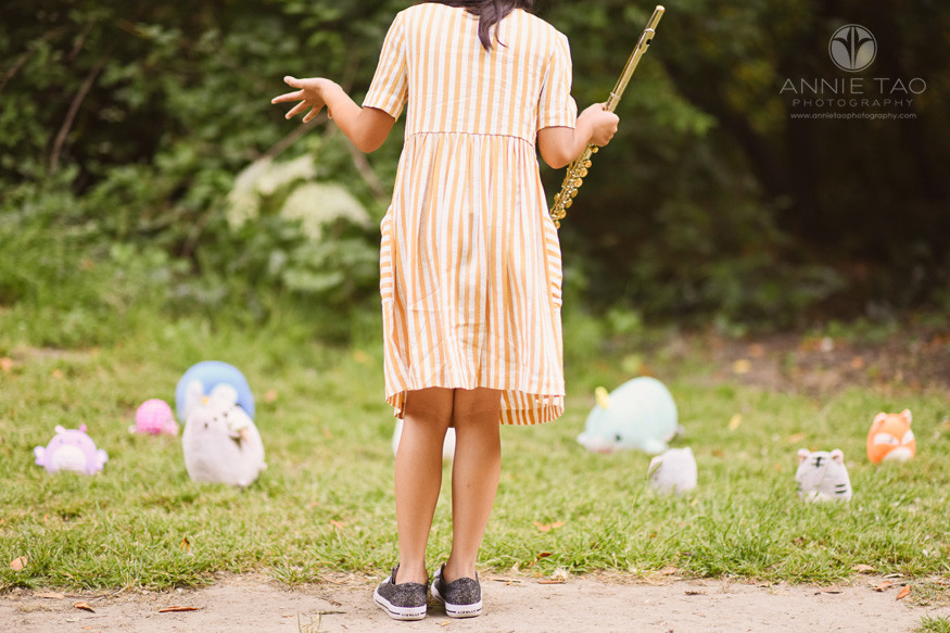 East-Bay-styled-children-photography-girl-flutist-talking-with-animals