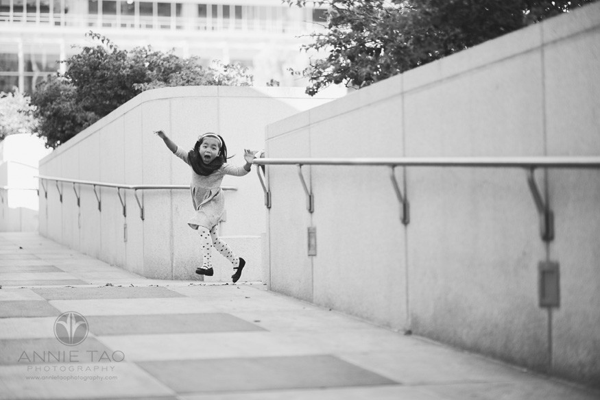 San-Francisco-lifestyle-children-photography-young-girl-jumping-from-behind-wall-BxW
