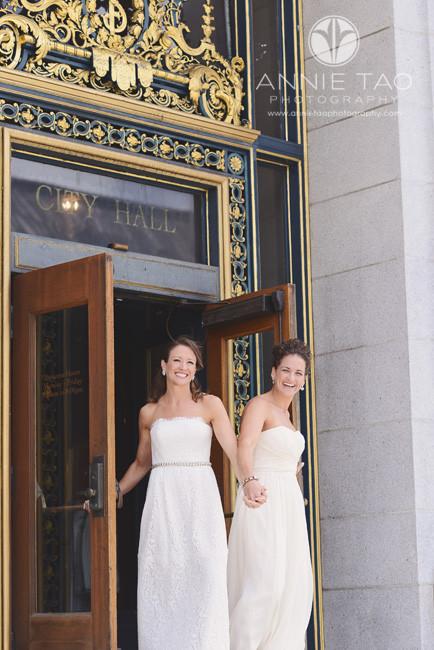 San-Francisco-wedding-photography-City-Hall-gay-wedding-brides-walking-out-of-City-Hall-doors