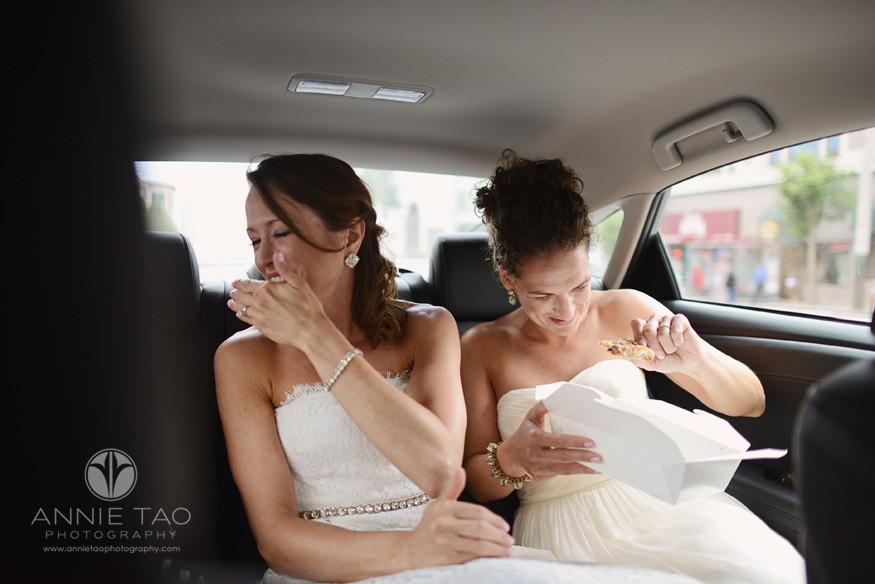 San-Francisco-wedding-photography-gay-wedding-brides-sharing-a-pizza-in-a-car
