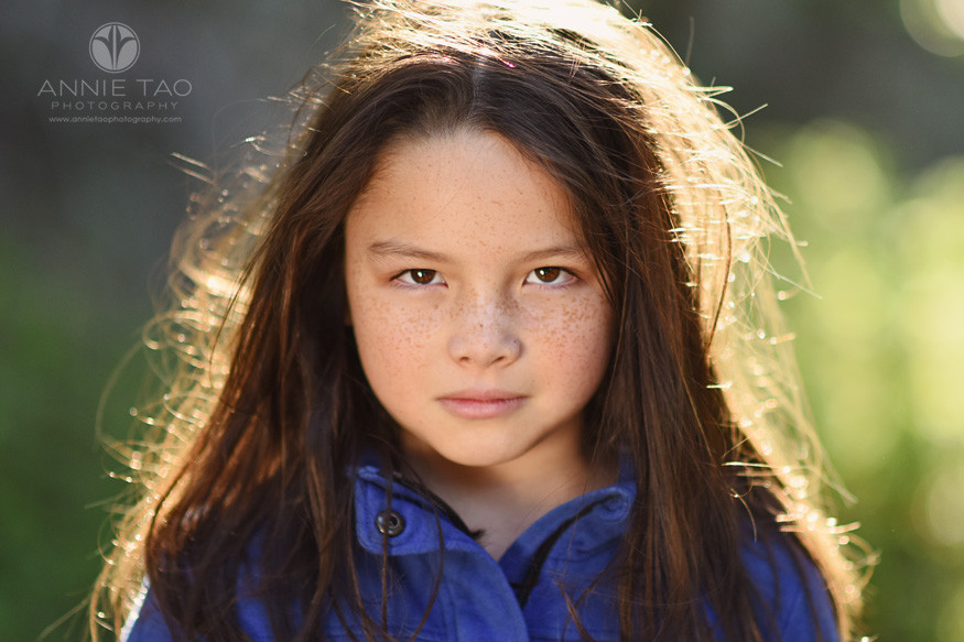 east-bay-styled-children-photography-girl-staring-with-fierce-eyes-and-freckles-cropped