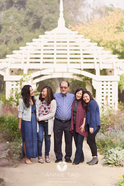 Bay-Area-lifestyle-family-photography-parents-with-their-adult-children-laughing-in-garden