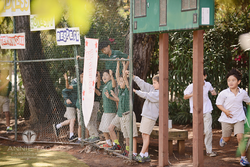 Bay-Area-Los-Altos-Commercial-Photography-students-watching-game-from-behind-the-fence