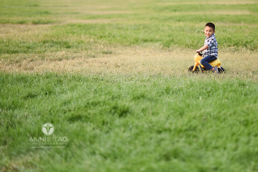 South-Bay-lifestyle-photography-preschooler-boy-on-riding-toy-motorcycle-in-grass