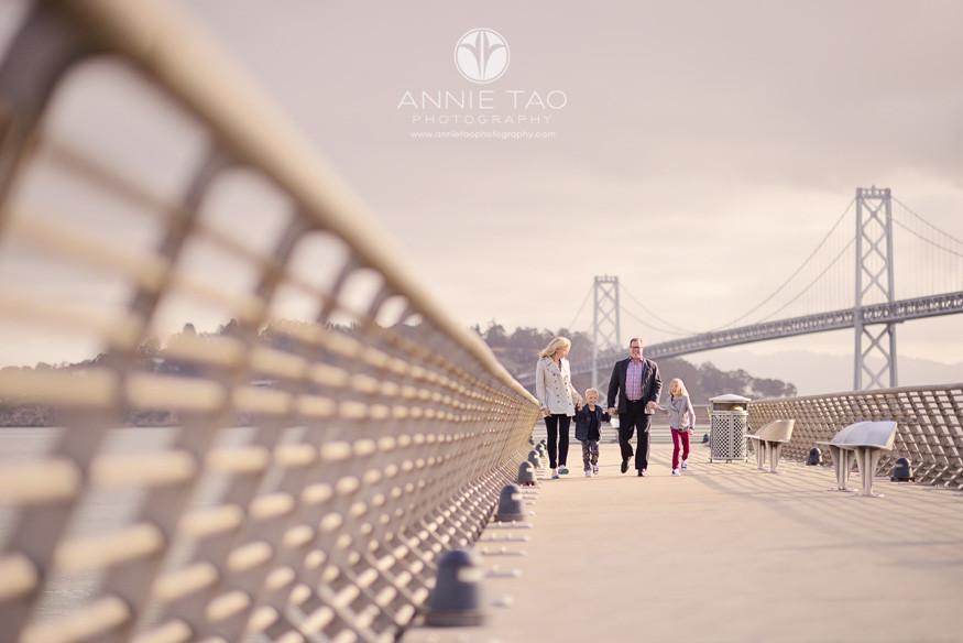 San-Francisco-lifestyle-family-photography-family-walking-on-pier-near-Bay-Bridge
