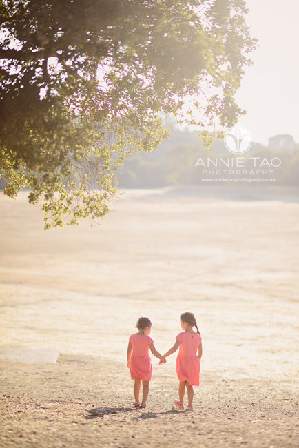 San-Francisco-Bay-Area-Peninsula-lifestyle-children-photography-sisters-holding-hands-and-walking-into-the-savannah
