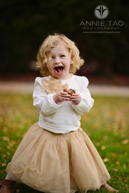 San-Francisco-Bay-Area-Peninsula-lifestyle-children-photography-one-year-old-baby-girl-in-at-tulle-skirt-and-eating-a-muffin