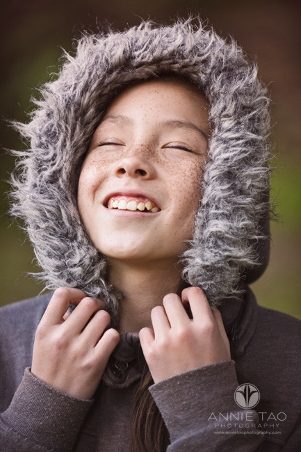 east-bay-styled-children-photography-girl-with-freckles-facing-upwards-with-hoodie