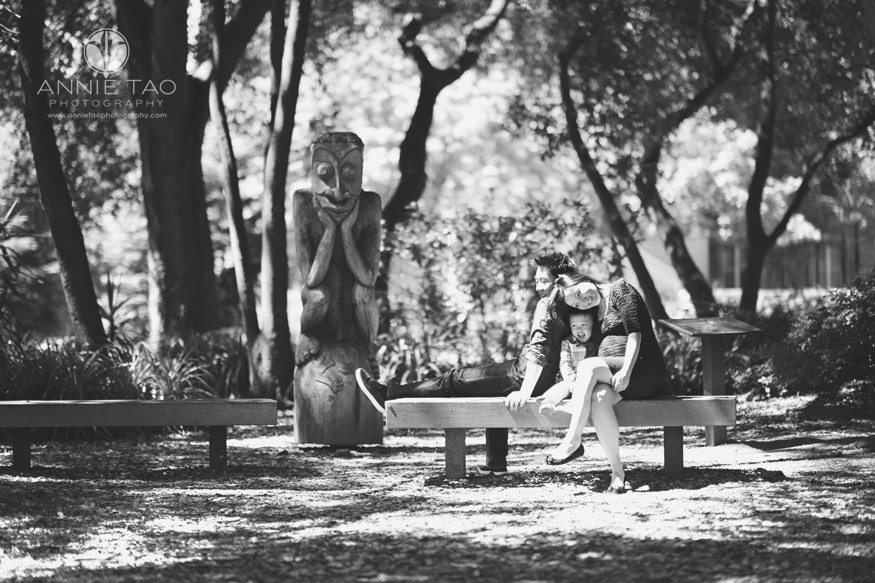 Bay-Area-lifestyle-family-photography-couple-leaning-into-toddler-son-by-statue-BxW