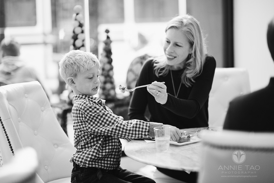 Bay-Area-lifestyle-family-photography-mother-trying-to-feed-son-BxW