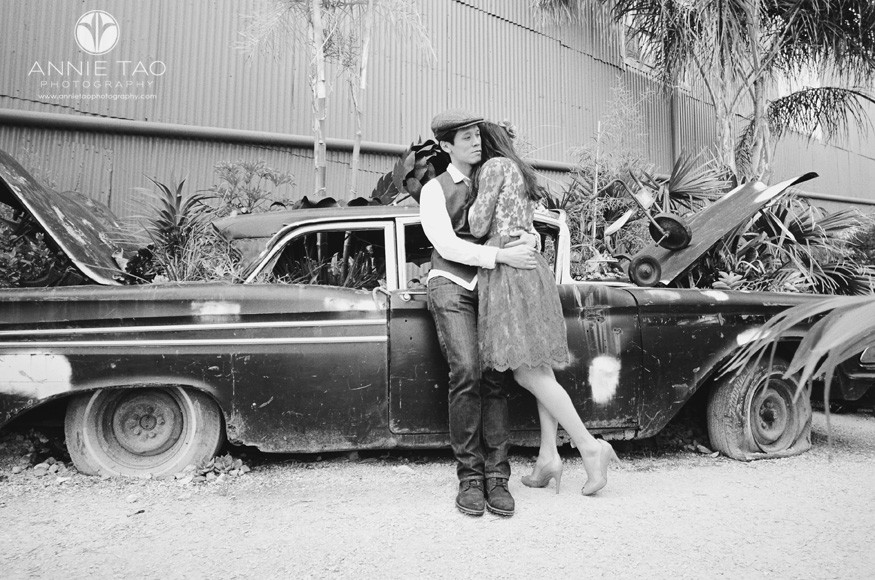 San-Francisco-styled-engagement-photography-session-couple-leaning-against-a-car-at-a-garden-nursery