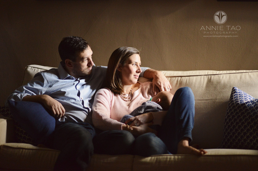 san-francisco-lifestyle-baby-photography-serene-family-holding-sleeping-baby-on-couch