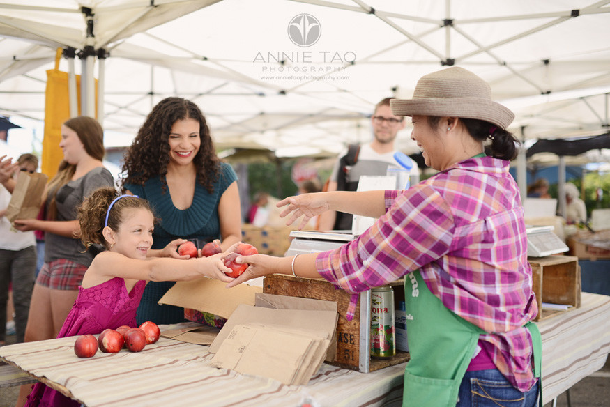 East-Bay-Commercial-Photography-family-giving-produce-to-farmer-at-Berkeley-farmers-market