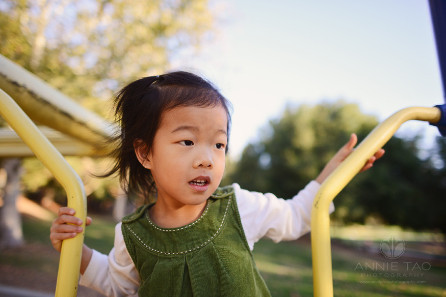 East-Bay-lifestyle-children-photography-young-girl-on-play-structure-color