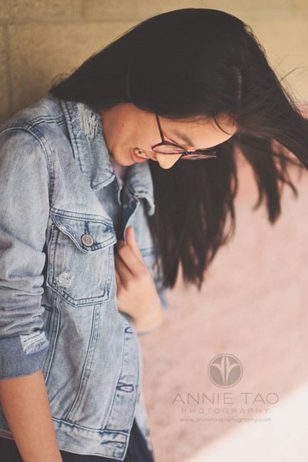 East-Bay-lifestyle-teen-photography-girl-looking-down-while-laughing-with-windblown-hair