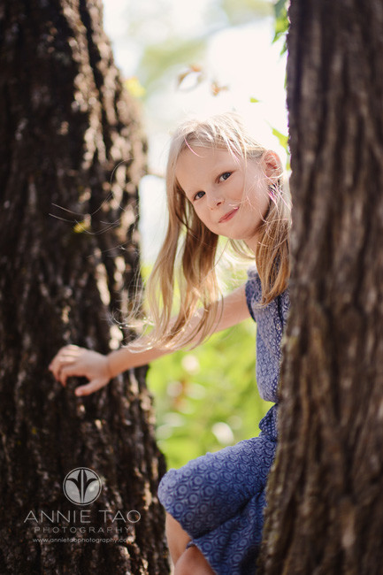 East-Bay-lifestyle-children-photography-girl-looks-over-after-climbing-tree